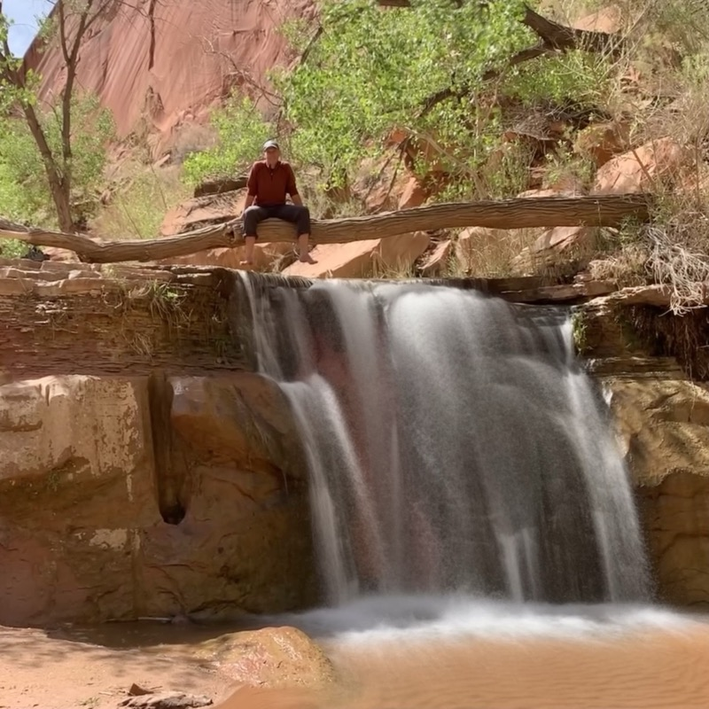 chris-perched-over-waterfall.jpg